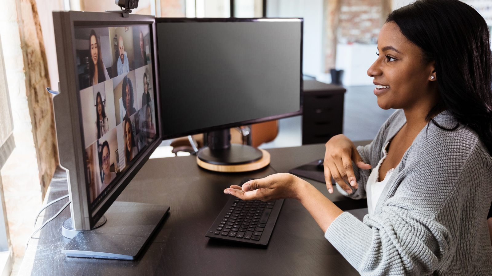 A young woman of color on a video call with her ovarian cancer support group